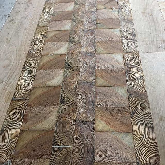 End grain floor tiles made from long leaf heart pine.