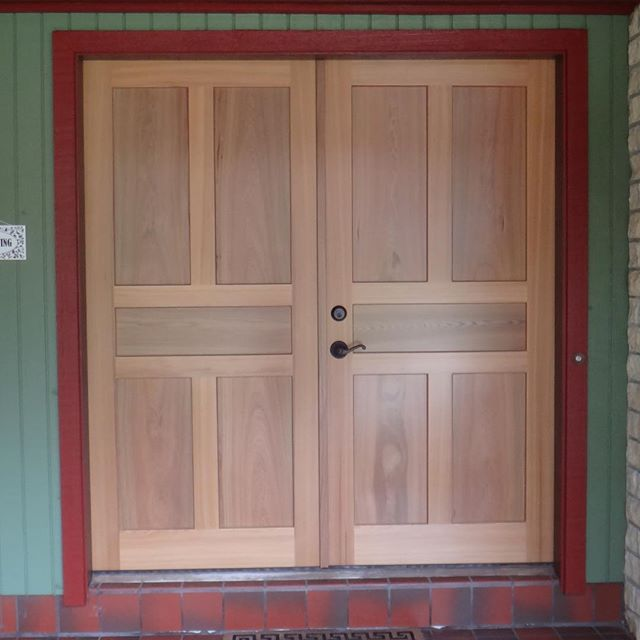 "River recovered cypress french doors  with 14"" wide matching solid wood panels, built and installed by"
