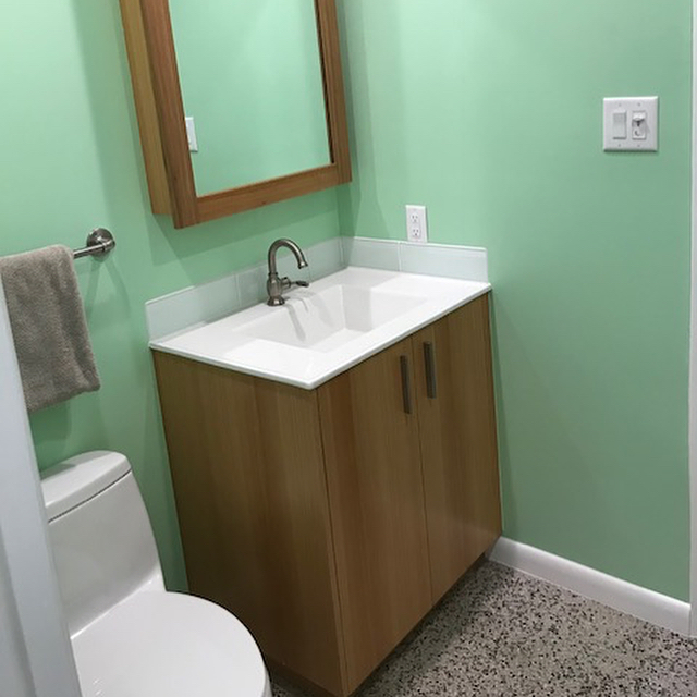 Custom River recovered cypress vanity and medicine cabinet