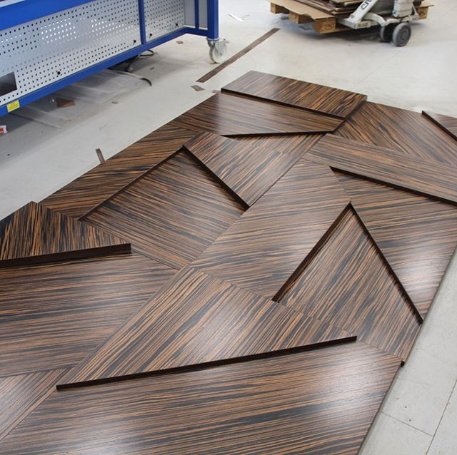 6 of 20 wall panels. Final measurement is 12' H X 15'L. Reconstituted Macassar Ebony. On it's way to Columbus, OH.