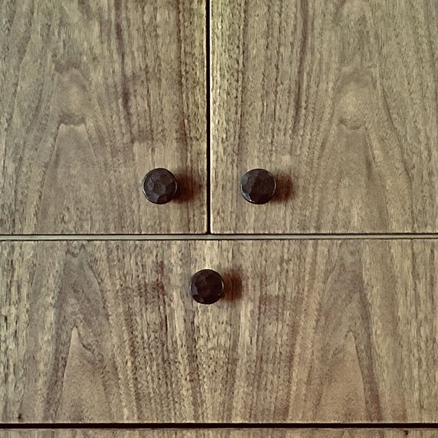 Black Walnut bedroom cabinets with a Swiss Pear back panel.